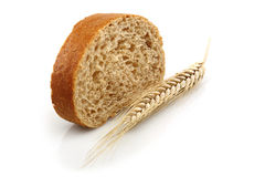 Wheat bread and Wheat. A wheat bread and shock of wheat on a white background Stock Image
