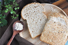 Wheat bread on wooden plate Stock Photos