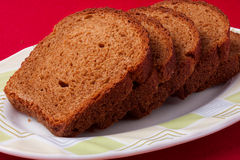 Wheat brown bread slices on white background Royalty Free Stock Photos