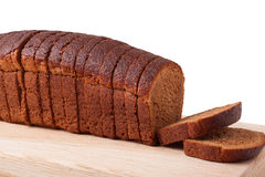 Wheat brown bread slices on white background Stock Photography