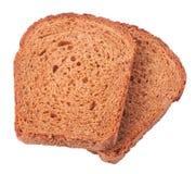 Wheat brown bread slices on white background Stock Photos