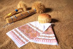 Wheat bundle. And bread on a grain background Royalty Free Stock Image