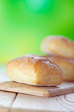 Wheat buns on breadboard Stock Images