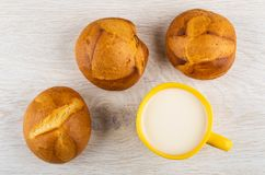 Wheat buns, cup of milk on table. Top view stock image
