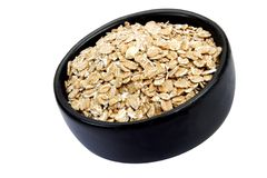 Wheat cereal. Bowl of wheat cereal on white background. It is common ingredient of healthy meal Stock Photography
