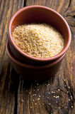 Wheat cereal in a bowl. On wooden background stock photography