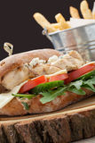 Wheat chicken sandwich burger, fried potatoes, mustard sauce. Se Stock Image