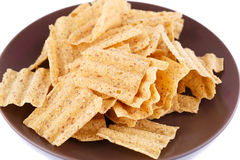 Wheat chips on plate Royalty Free Stock Photos