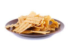 Wheat chips on plate Royalty Free Stock Photography