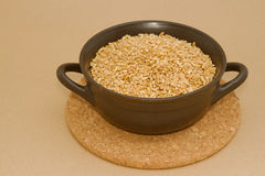 Wheat in clay bowl Stock Image