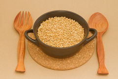 Wheat in clay bowl Stock Images