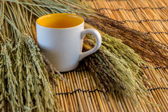 Wheat and coffee cup on bamboo mat Royalty Free Stock Image