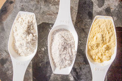 Wheat, corn and rye flour, on spoons Royalty Free Stock Photo