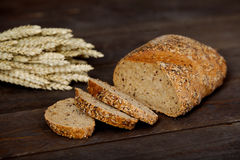 Wheat and corn. Wheat Seed and corn in dark wood table. Accompanied bread wheat seeds Stock Photo