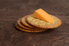 Wheat crackers with cheddar cheese Stock Photos