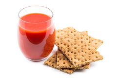 Wheat crisp bread and tomato juice in glass Royalty Free Stock Images