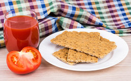 Wheat crisp bread, tomato and juice on table Royalty Free Stock Photography