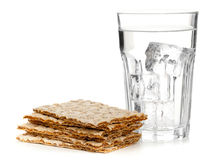 Wheat crispbread slices and glass of water Royalty Free Stock Photo