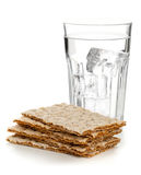 Wheat crispbread slices and glass of water Royalty Free Stock Photos