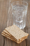 Wheat crispbread slices and glass of water Stock Photos