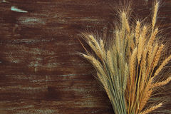 wheat crop on wooden table. Symbols of jewish holiday - Shavuot Stock Image