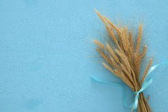 wheat crop on wooden table. Symbols of jewish holiday - Shavuot Stock Images
