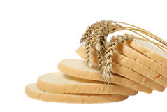 Wheat and cut bread Stock Image