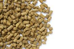 Wheat distiller pellets. Animal feed on white background Stock Photo