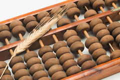 Wheat ear on the abacus Royalty Free Stock Photos