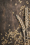 Wheat ears. On an old wooden plank Royalty Free Stock Photo