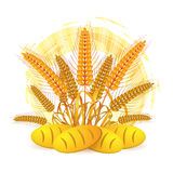 Wheat ears with bread. Over white background Stock Photography