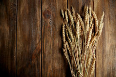 Wheat ears on brown wooden background Royalty Free Stock Photography