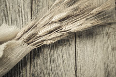 Wheat Ears over Rustic Wood and Burlap Royalty Free Stock Image
