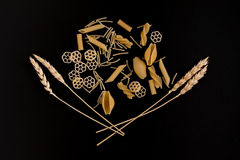 Wheat ears are surrounded by pasta Royalty Free Stock Photos