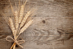 Wheat ears on wood Stock Photo