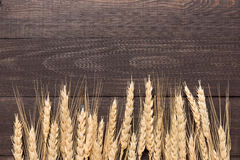Wheat ears on the wooden background. Top view Stock Image