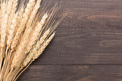 Wheat ears on the wooden background. Top view Royalty Free Stock Photos
