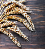 Wheat ears on the wooden table Royalty Free Stock Photography