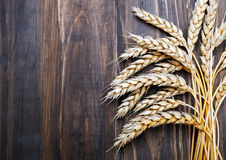 Wheat ears on the wooden table Royalty Free Stock Image
