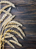 Wheat ears on the wooden table Royalty Free Stock Photo