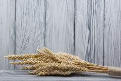 Wheat Ears on Wooden Table. Sheaf of Wheat over Wood Background. Harvest concept. Wheat Ears on Wooden Table. Sheaf of Wheat over Wood Background. Harvest Stock Photos