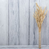 Wheat Ears on Wooden Table. Sheaf of Wheat over Wood Background. Harvest concept. Wheat Ears on Wooden Table. Sheaf of Wheat over Wood Background. Harvest Stock Image