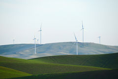 wheat farm hill with wind mill Stock Images