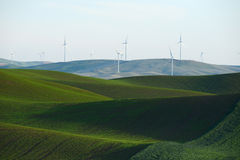 Wheat farm hill with wind mill Stock Photo