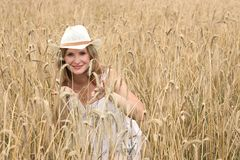 Wheat field. Smailing woman in a wheat field Royalty Free Stock Images