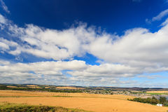 Wheat field and blue sky with clouds at shore line. Close to North sea, Aberdeen, Scotland, UK Stock Photo
