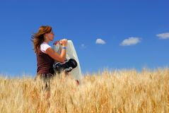 Wheat Field Dreams. Pretty young wake boarder in Durum Wheat field, dreaming of water Stock Photos