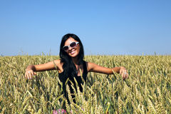 Wheat field and girl Stock Photos