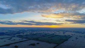 Wheat fields. Beautiful scenery from a height in sunset time. Photos from the height. The wheat fields. Shooting at a drone. Beautiful landscape from a height Royalty Free Stock Photography