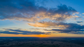 Wheat fields. Beautiful scenery from a height in sunset time. Photos from the height Royalty Free Stock Photography